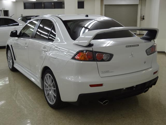 photo used mitsubishi lancer evolution 10 2013 model white color back