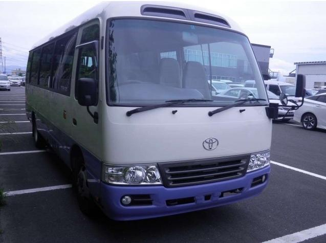 Used Toyota Coaster Bus photo: 2014 model White and Lavender Two Tone color - Front view