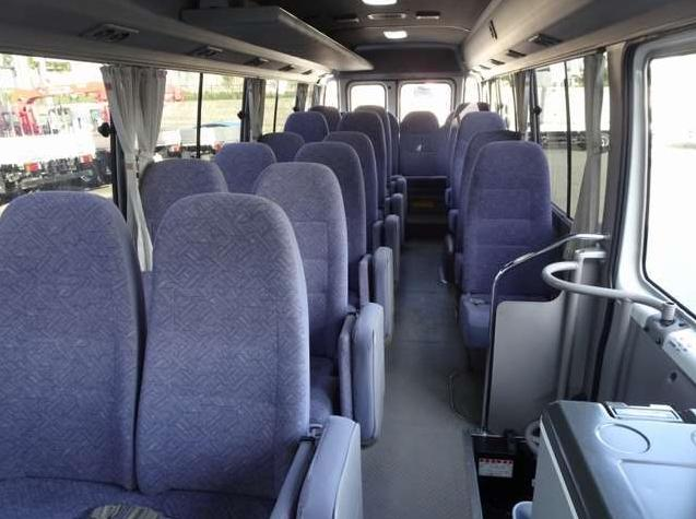 Used Toyota Coaster Bus photo: 2014 model White and Lavender Two Tone color - Interior view